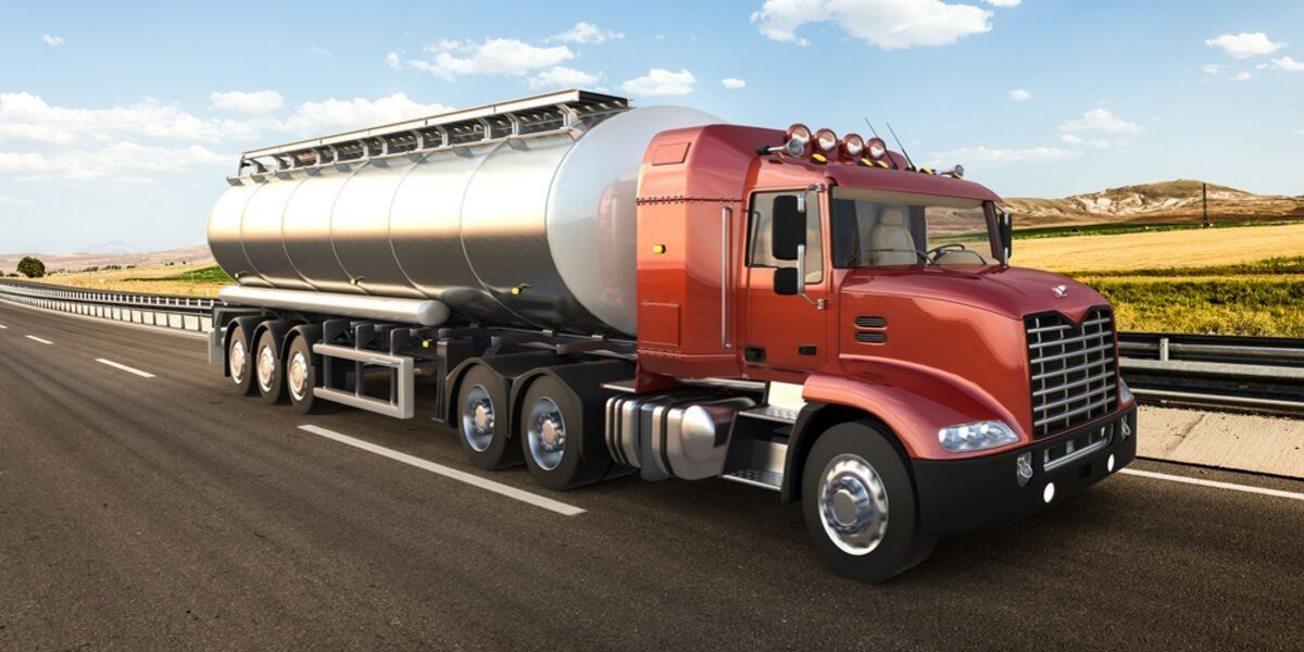 Tank truck driving on highway