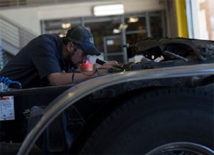 Cat Mechanic servicing a Diesel Engine