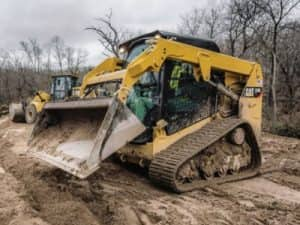 Track dozer in dirt patch in the woods