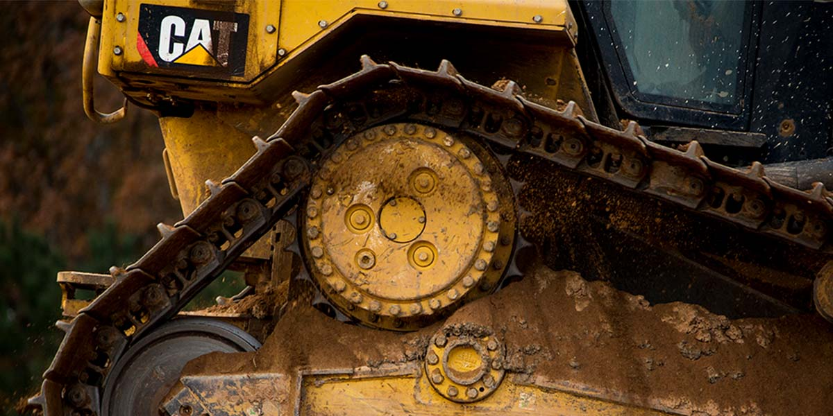 Close up of the undercarriage of Cat vehicle