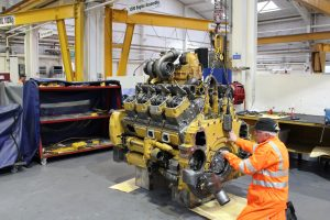 CAT mechanic servicing engine