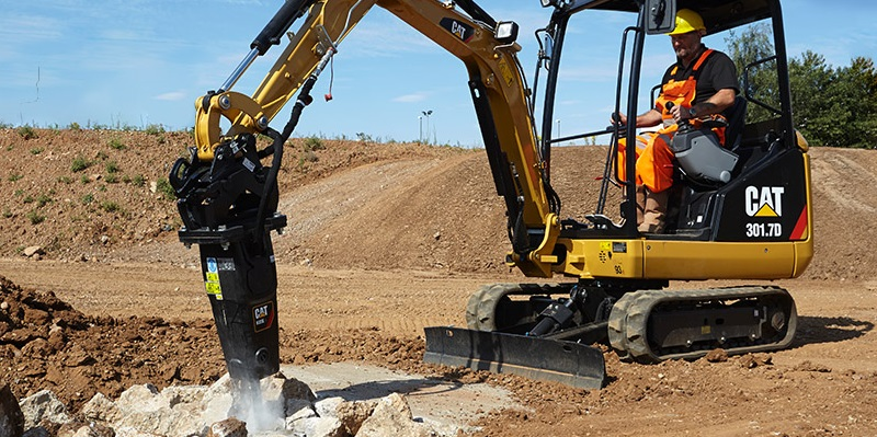 Cat mini excavator with drill attachment